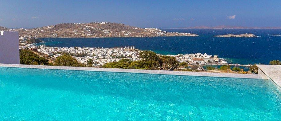enchanting view of the glistening blue sea and the city of Mykonos