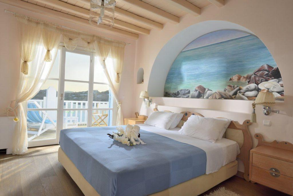 bedroom with wooden floor and beautiful paint of sea