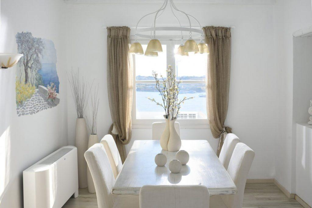 dining area with white table and chairs