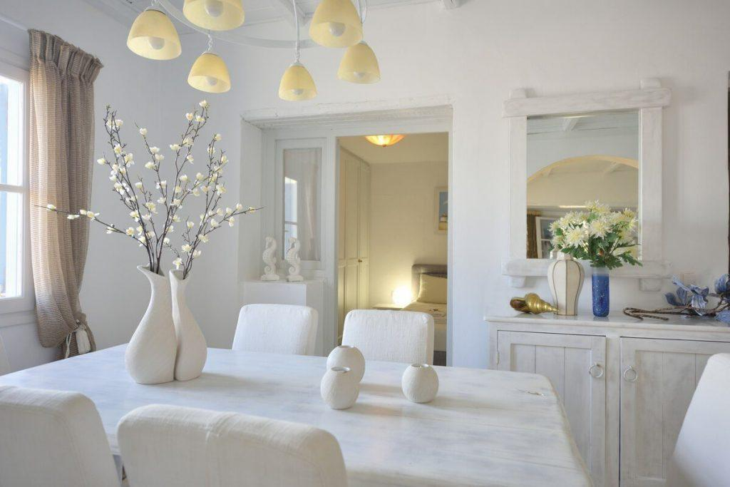 dining area with flowers that fill the room