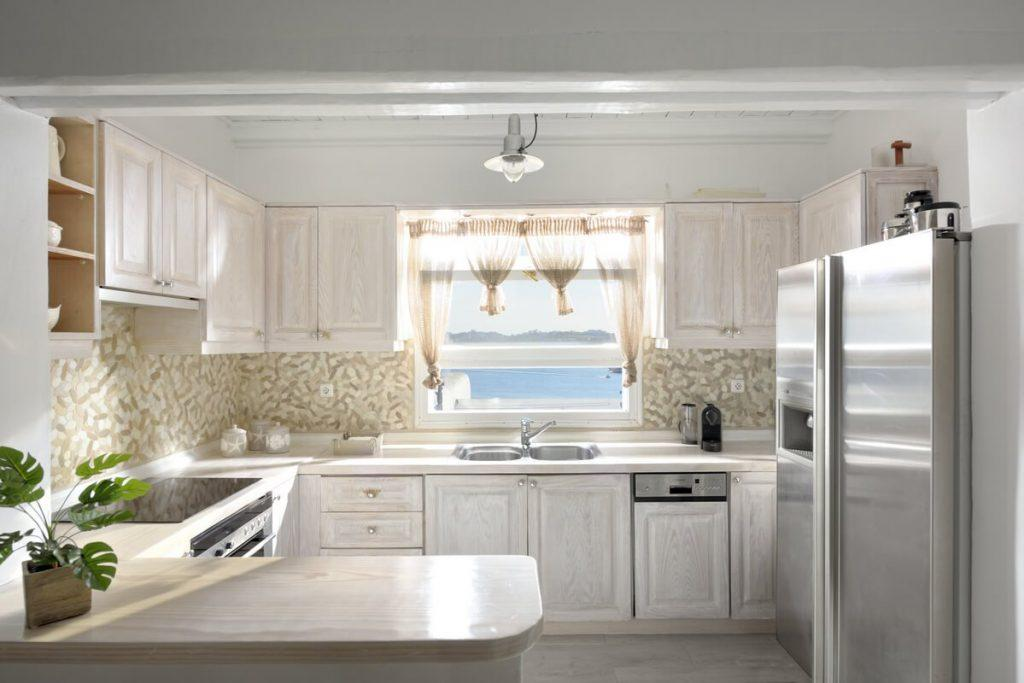 kitchen with huge fridge white cabins and still oven