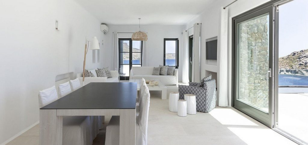Villa Charisma Kalafatis Mykonos living room, dining table, A/C, chairs