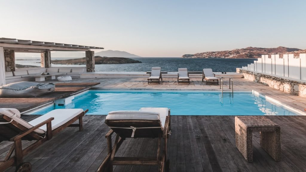 Villa Felicity Kanalia Mykonos Outdoors sunbeds pool with the panoramic view 2