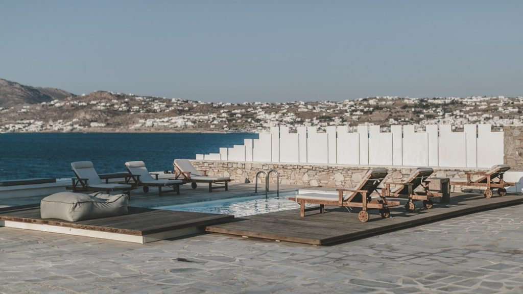 Villa Felicity Kanalia Mykonos Outdoors sunbeds pool with the panoramic view 1