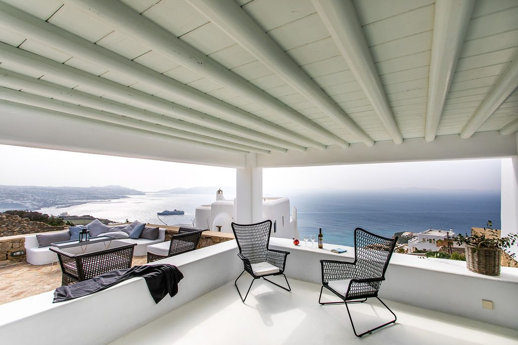 Villa Grace Agios Stefanos Mykonos Balcony lounge area with the panoramic view