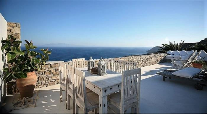 Villa Peridot Elia Mykonos outdoors dining area with the panoramic view