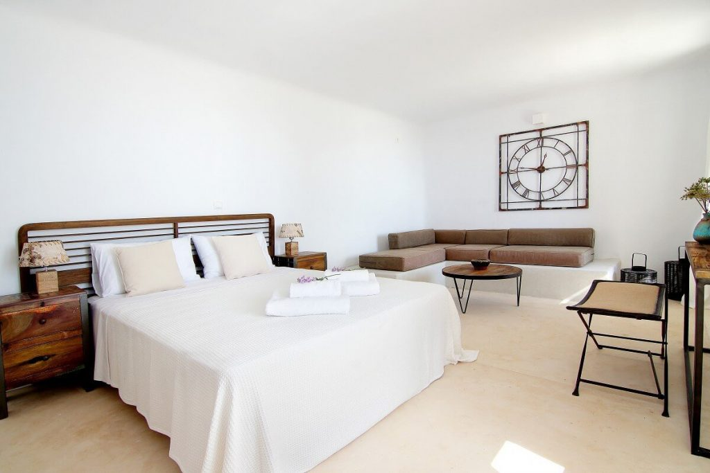 Villa Jennifer Fanari Mykonos 1st bedroom, sofa, big clock, coffee table