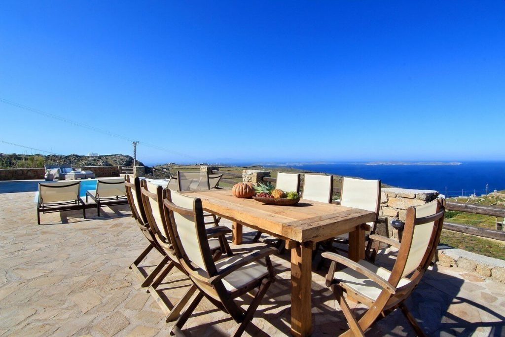 Villa Jennifer Fanari Mykonos outdoor dining area, swimming pool, fruits, sunny day, panoramic view