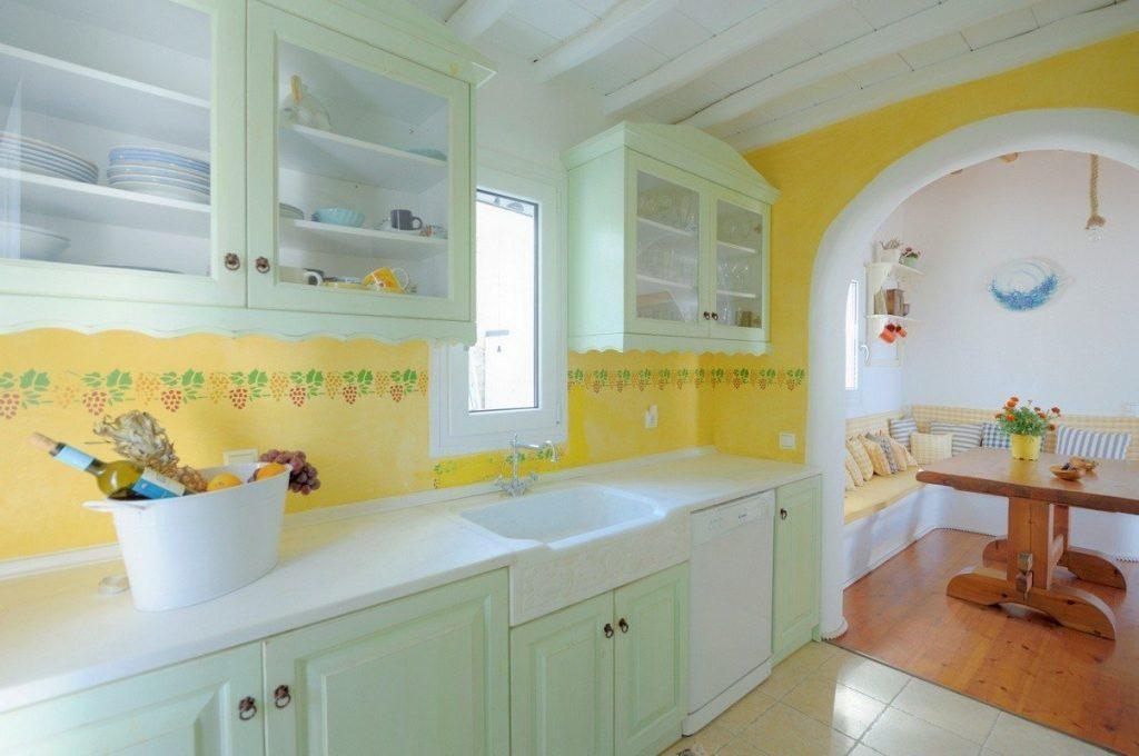 yellow wall kitchen with greenish wooden cabins