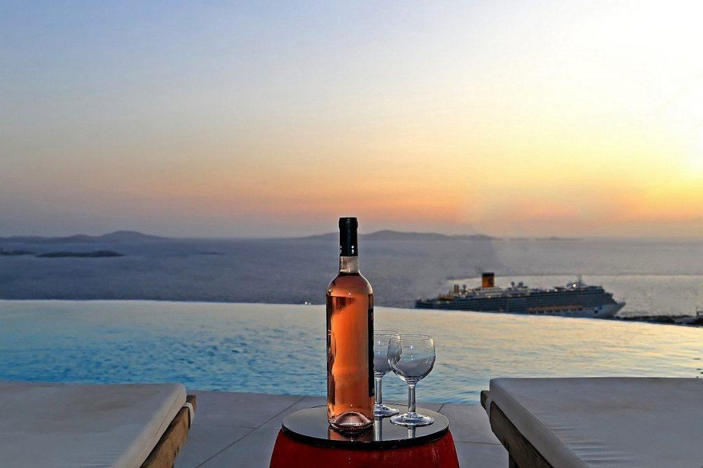 Villa Lena Tourlos Mykonos swimming pool, wine, two wine glasses