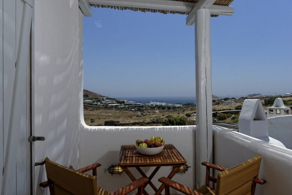 Villa Lucia Kalafatis Mykonos Panoramic view, chairs, coffee table, fruit