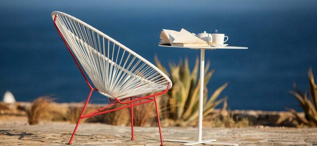 Villa Naomi Elia Mykonos outdoor chair, book, tea