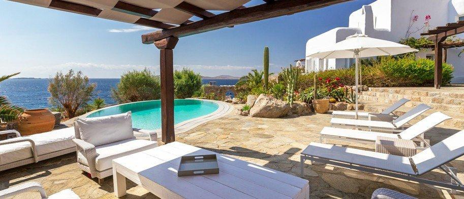 Villa Nautilus Agios Ioannis Mykonos Swimming pool, lounge area, sun beds, coffee table, chair