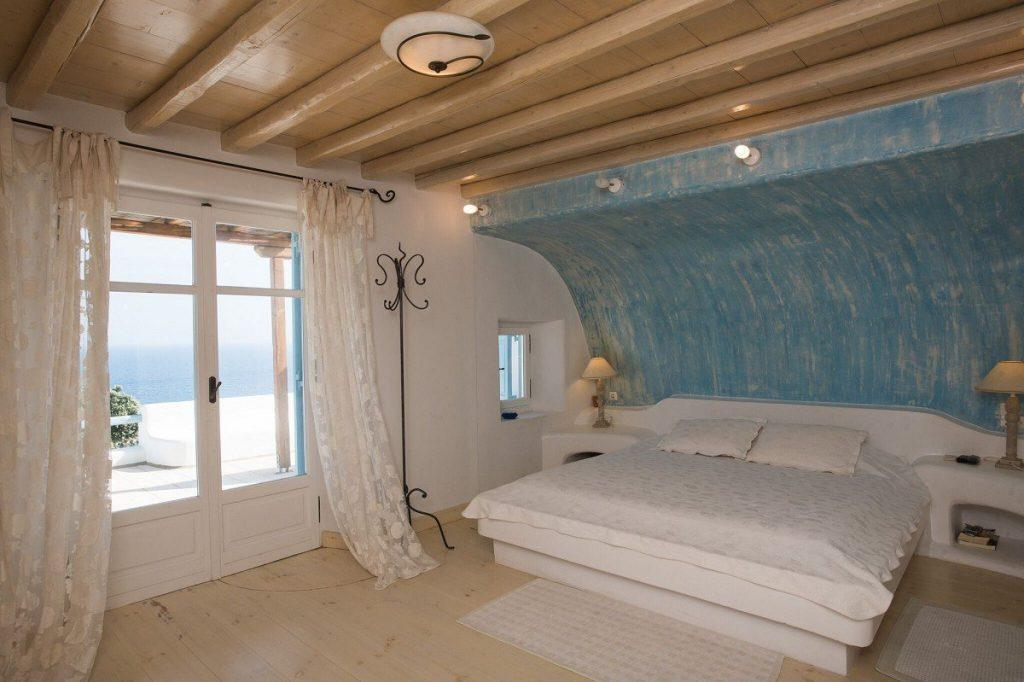 bedroom with a wall above the bed in the shape of a wave