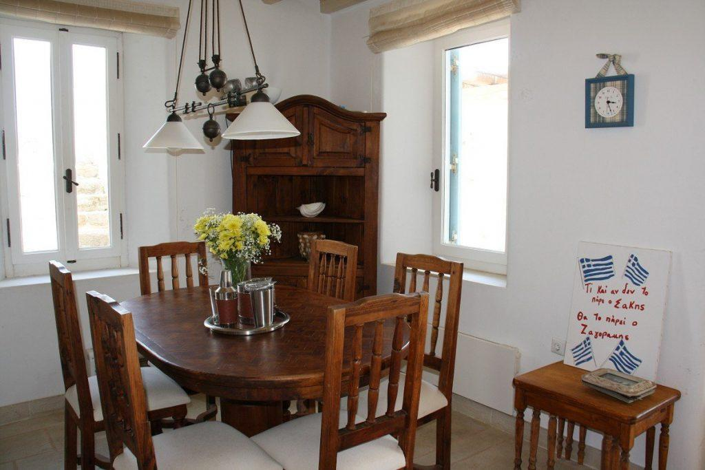 dining area with wooden table chairs and cabin