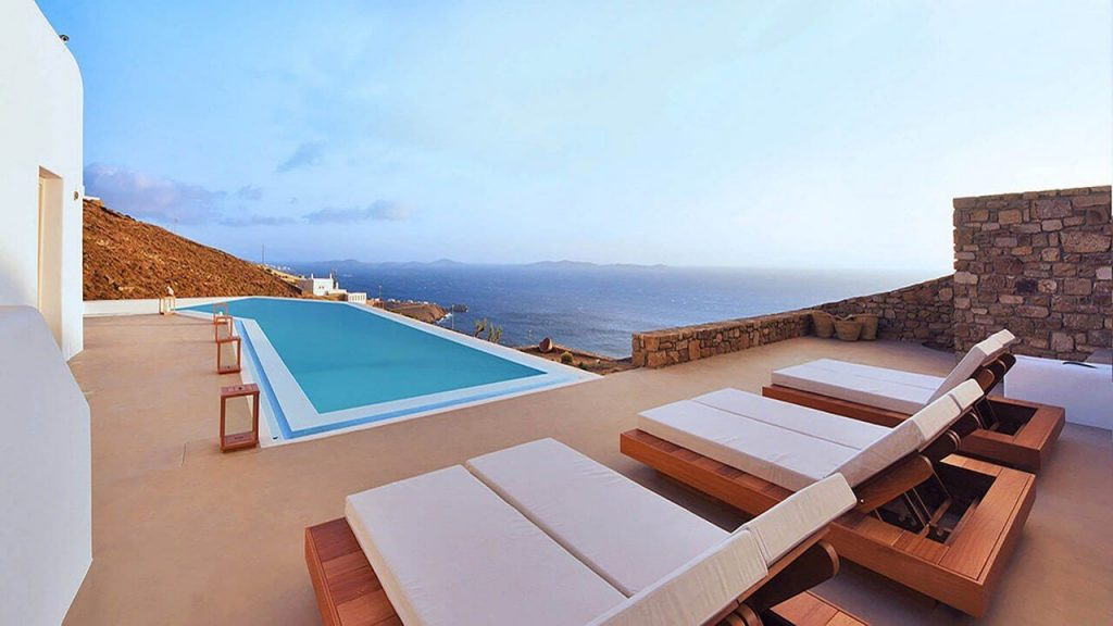 Villa Soto Houlakia Mykonos Swimming pool, sunbeds and the part of the panoramic view