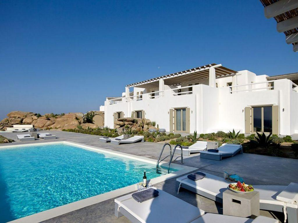 Villa Supreme Paraga Mykonos swimming pool, wine, glasses, fruit on the plate, garden