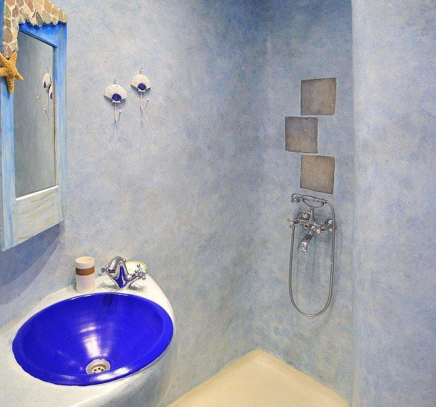 bathroom with shower and blue washstand