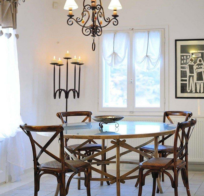 dining area with nice chandelier and round glass table