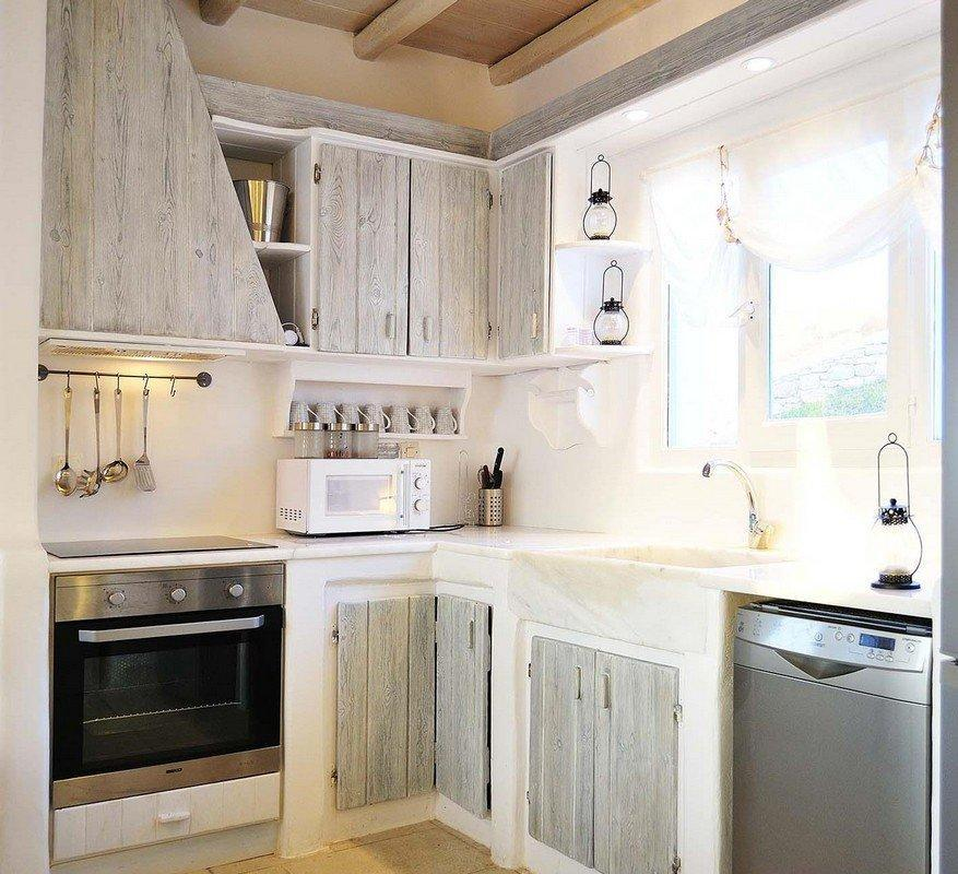 kitchen with still oven wooden cabins and microwave