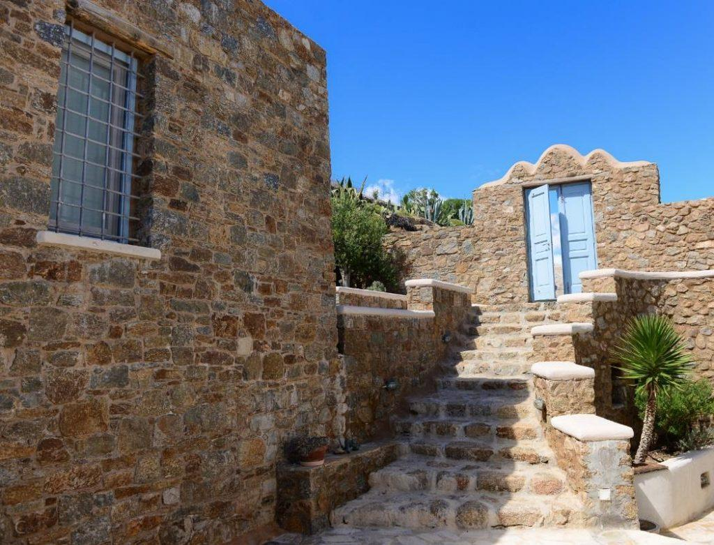 outdoor area with stone walls and stairs