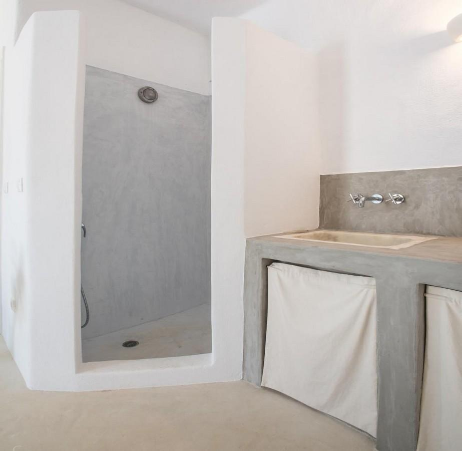 bathroom with shower and ceramic sink