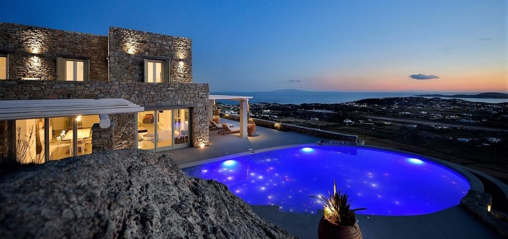 Villa Evangeline Kounoupas Mykonos Outdoors and pool at night with panoramic view