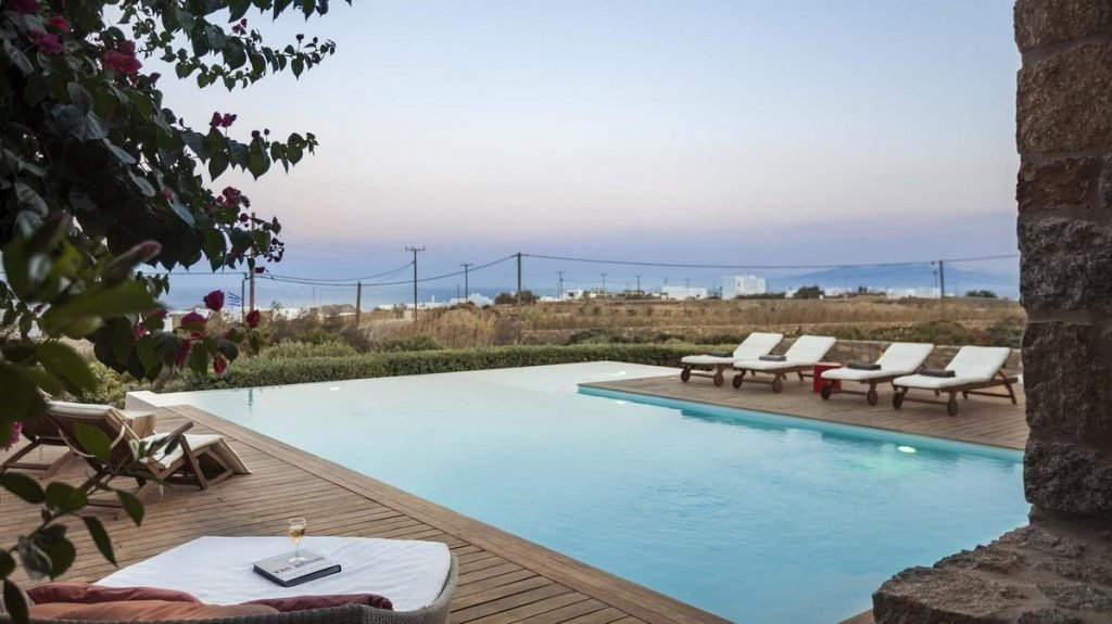 Villa Seraphina Kalafatis Mykonos Outdoors sunbeds and pool with the panoramic view 1
