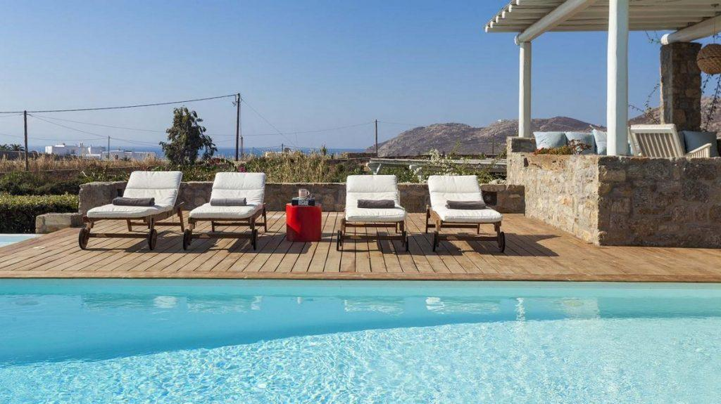 outdoor area with white soft climbers and towels