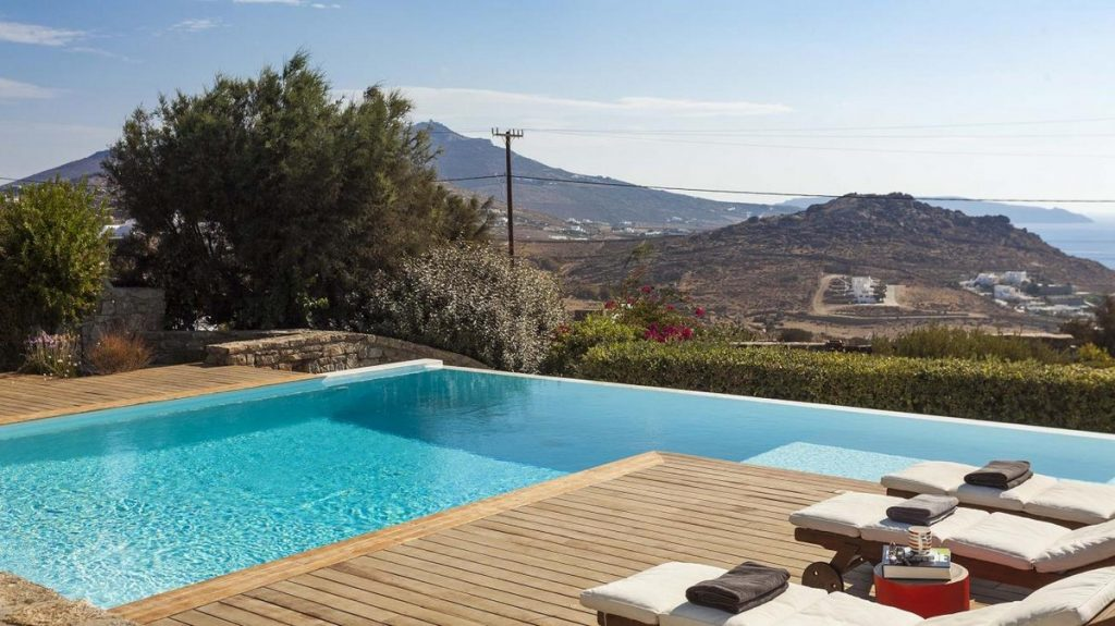 Villa Seraphina Kalafatis Mykonos Outdoors sunbeds and pool with the panoramic view