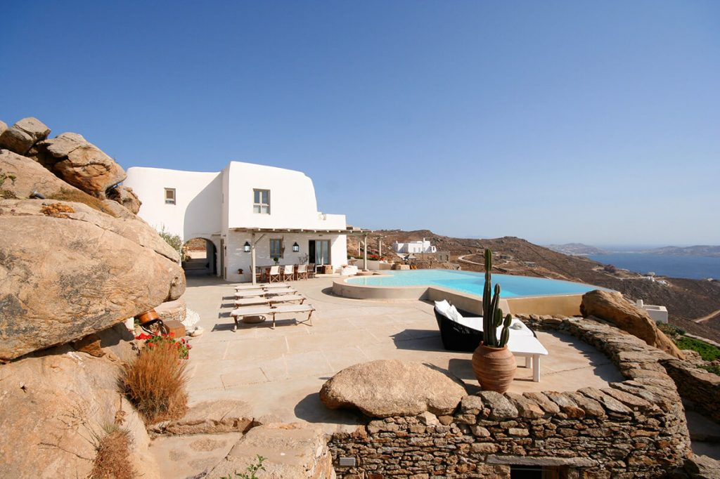 Villa Skyler Fanari Mykonos pool with sunbeds and the panoramic view