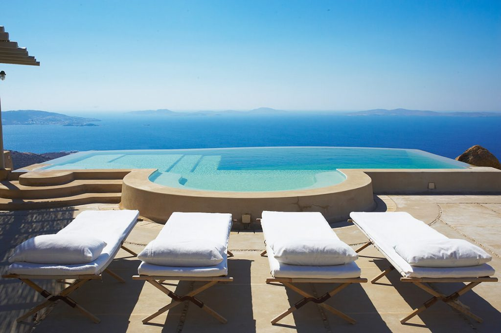 Villa Skyler Fanari Mykonos pool with sunbeds and the panoramic view 1