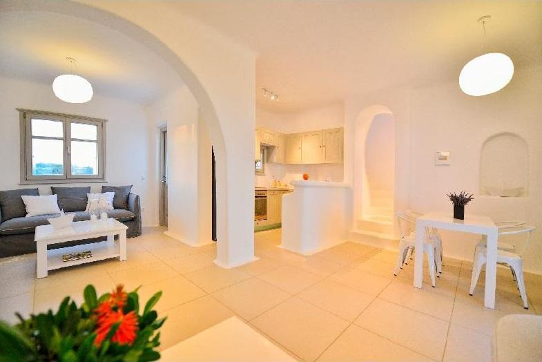 spacious area with tiled floor and white table