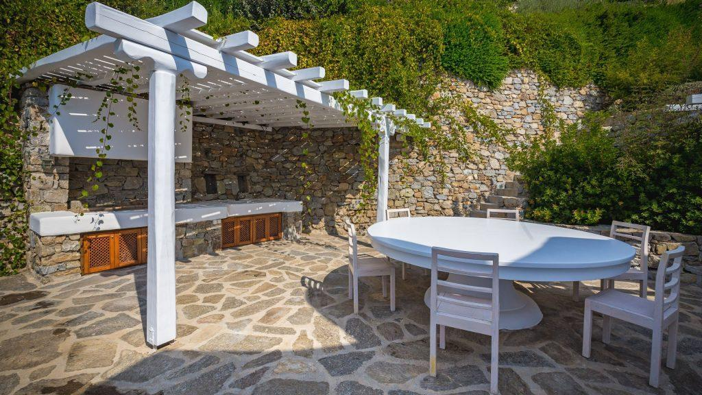 outdoor area with huge round white table and chairs