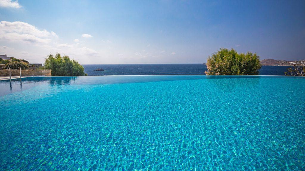 outdoor area with infinity pool and beautiful view