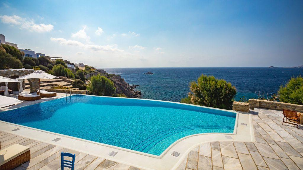 outdoor area with tiled floor and breathtaking horizon sea view