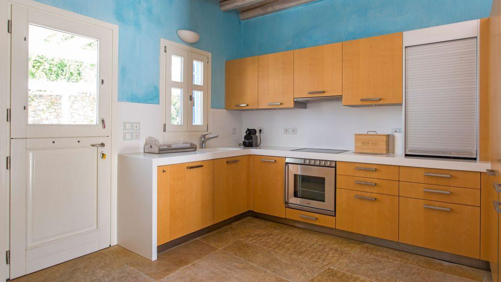 kitchen with tiled floor and wooden cabins