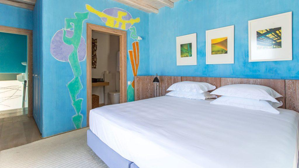 bedroom with huge bed and wall paints