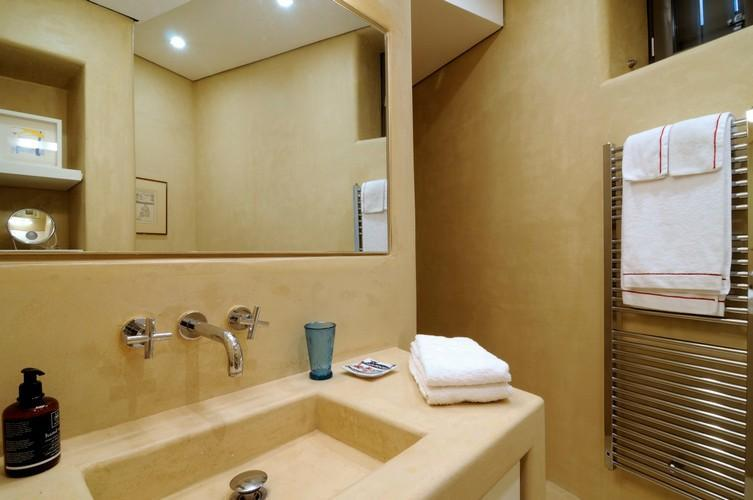 bathroom with towels on the sink and rack