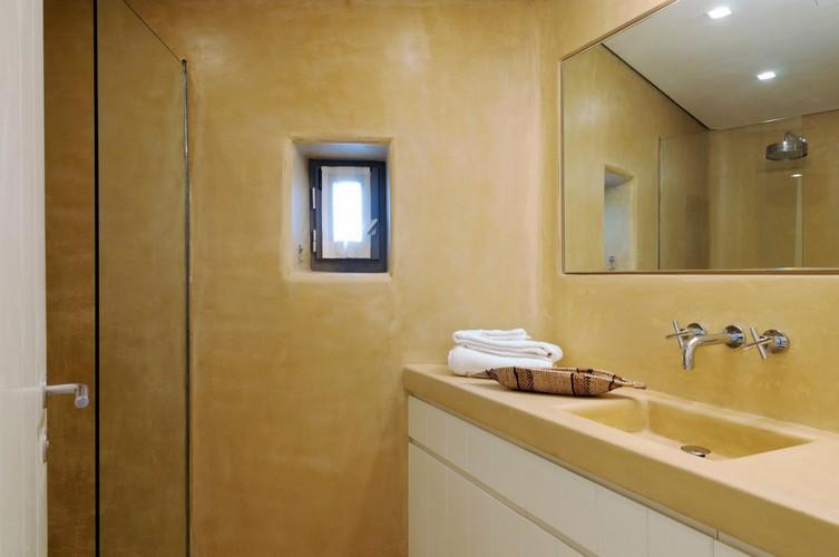 bathroom with big mirror and extensive sink to get ready daily activities