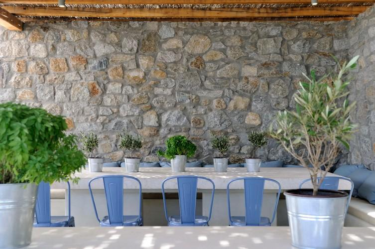 table and chairs in the villa porch perfect to have a breakfast with your family and friends