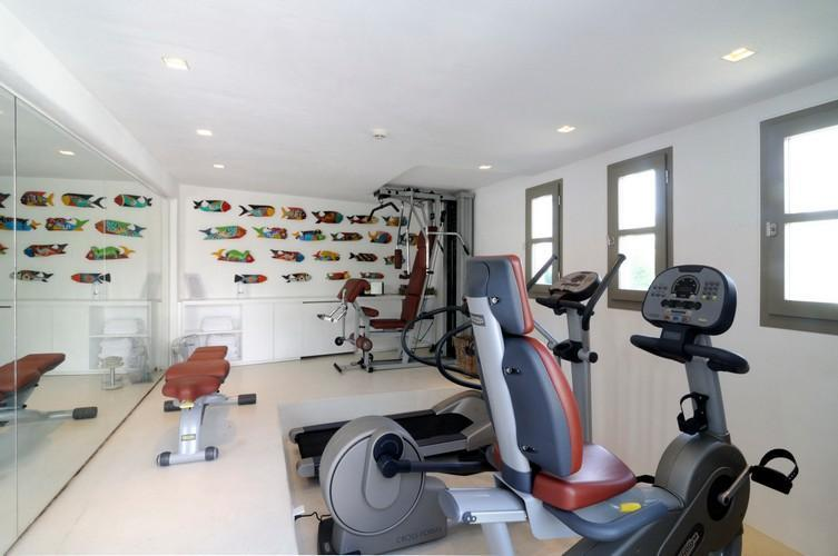 bright gym room so you don`t miss your training with treadmills exercise bike and gladiator machine