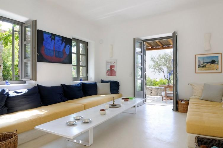 living area with a table and comfortable sofas to sit down