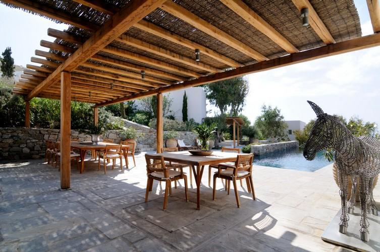 wooden table and chairs in the villa garden perfect to hang out with your friends