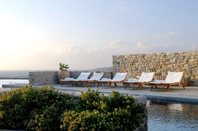 ideal place to sunbath and get perfect tan with your friends in next to pool sunbeds