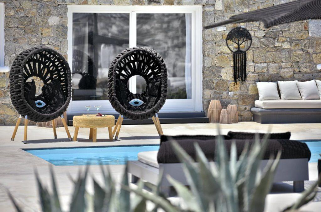 outdoor area with black unique designed chairs and round table