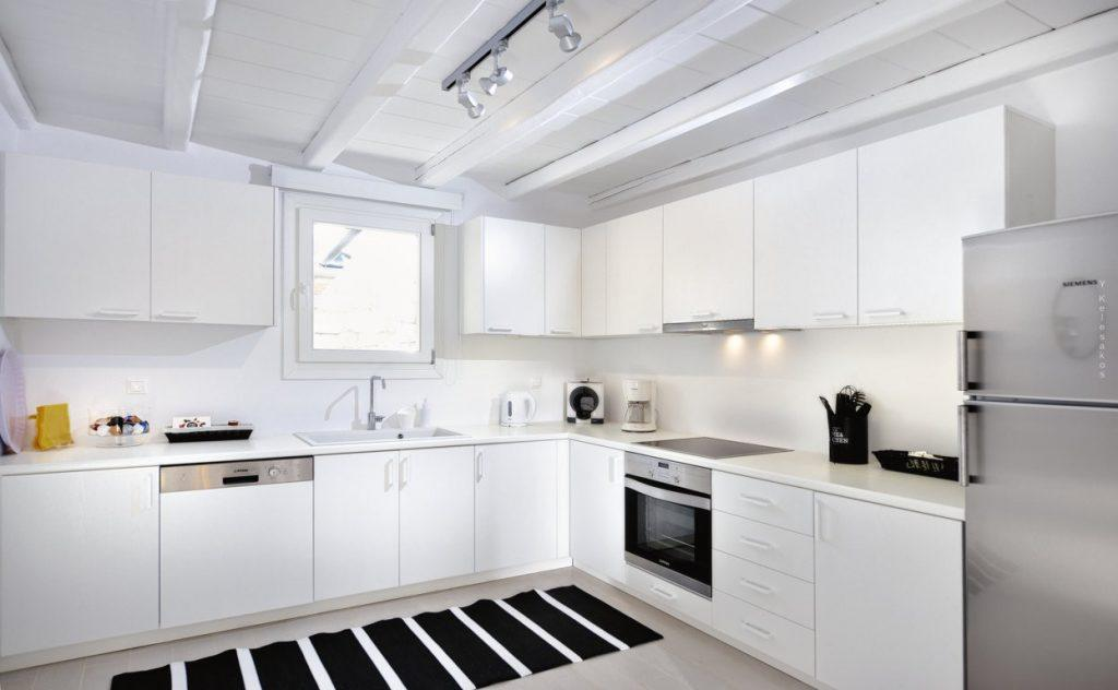 full equip kitchen with white cabins and still oven