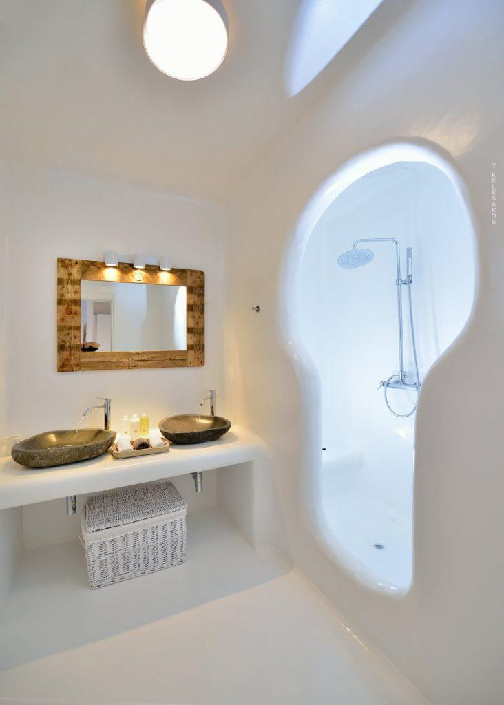 bathroom with unusual shape shower and towel basket