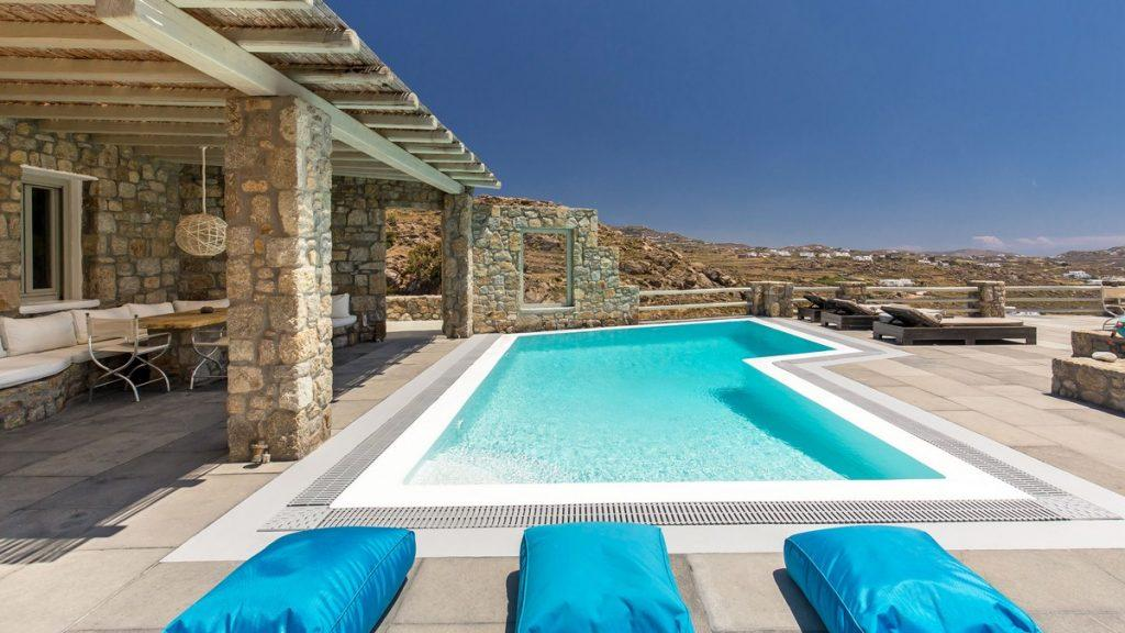 outdoor area with blue soft climbers and pool