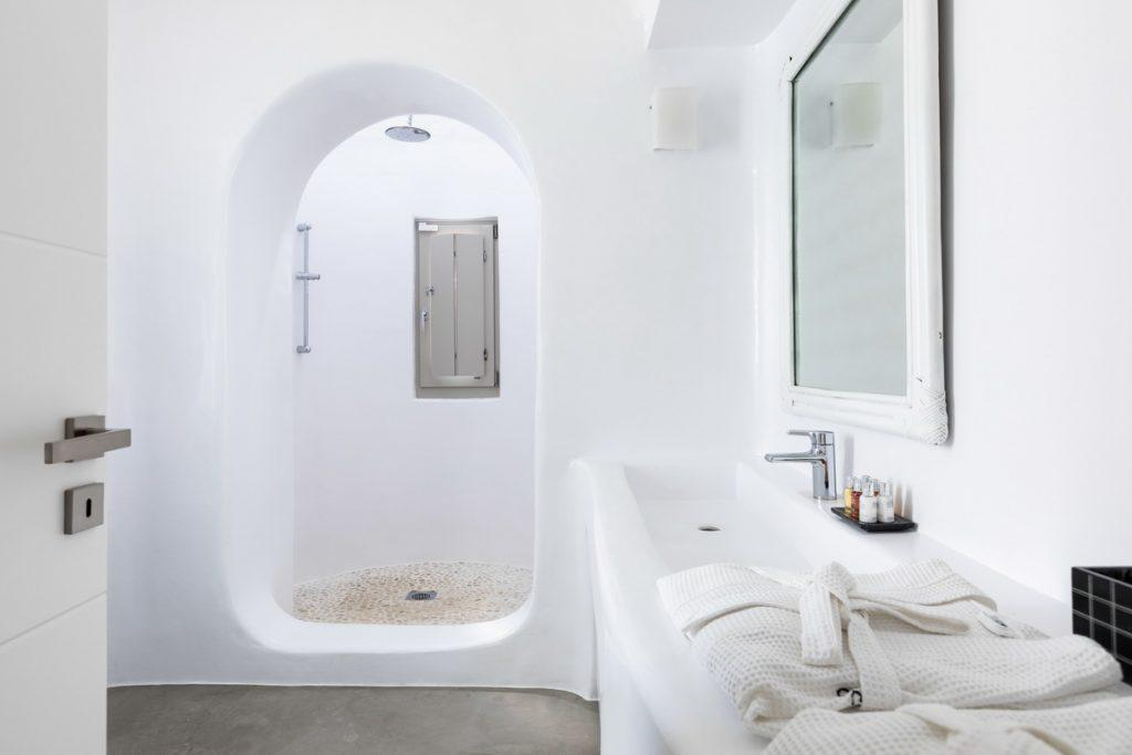 bathroom with large mirror and window
